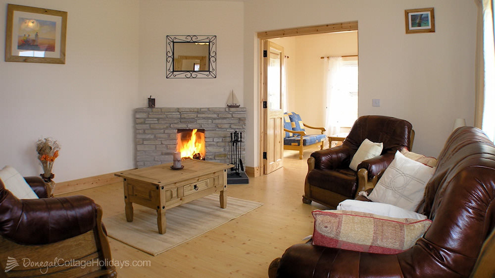 Otway Cottages Donegal - living room leading to sunroom