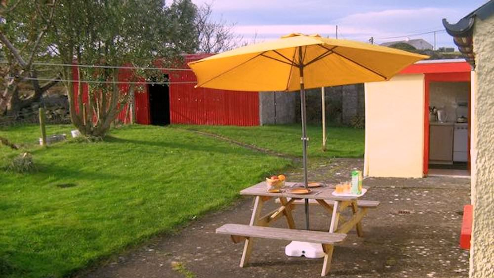 Patio Area and back garden at Cosy Nook