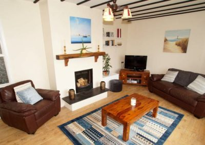 Anny Far and Near Rathmullan - living room with open fireplace