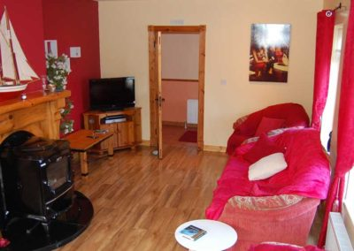 Pebble Cottage Malin Head Inishowen - living room with solid fuel stove