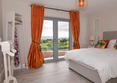 Pierview House Buncrana - ground floor king size double with patio doors and sea views