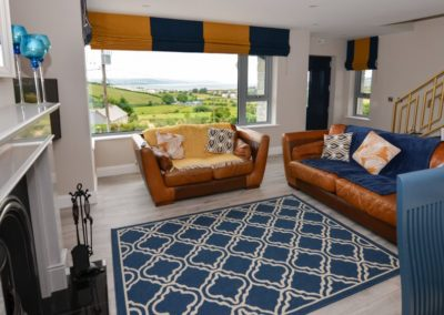 Pierview House Buncrana - living area with open fireplace