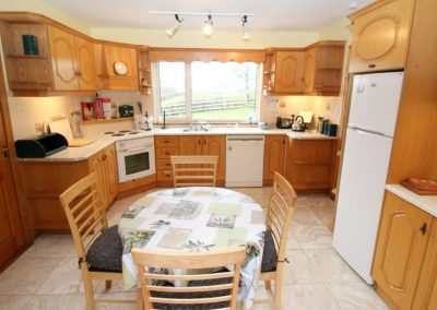 The holiday home kitchen with breakfast table