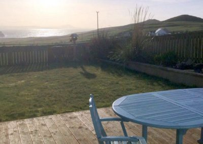 Patio Area and enclosed garden with lovely sea views