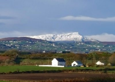 Snow capped Inishowen hills as viewed from Ard na Mara