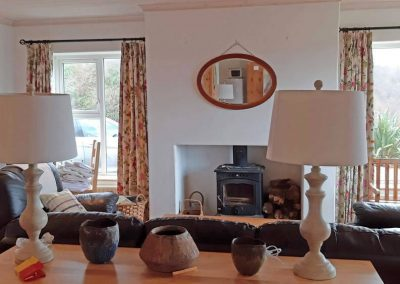The living area has a wood burning stove