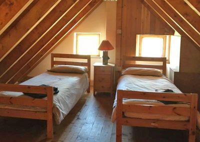 Seaside Thatch Cottage - twin bedroom in loft
